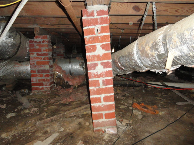 Severely leaning column in crawlspace.  62 year old Jackson home.