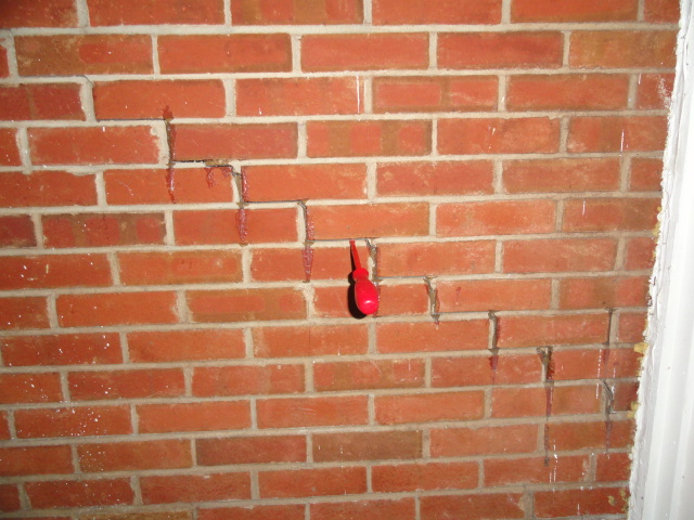 Step crack in brick veneer wall in Brandon, Mississippi